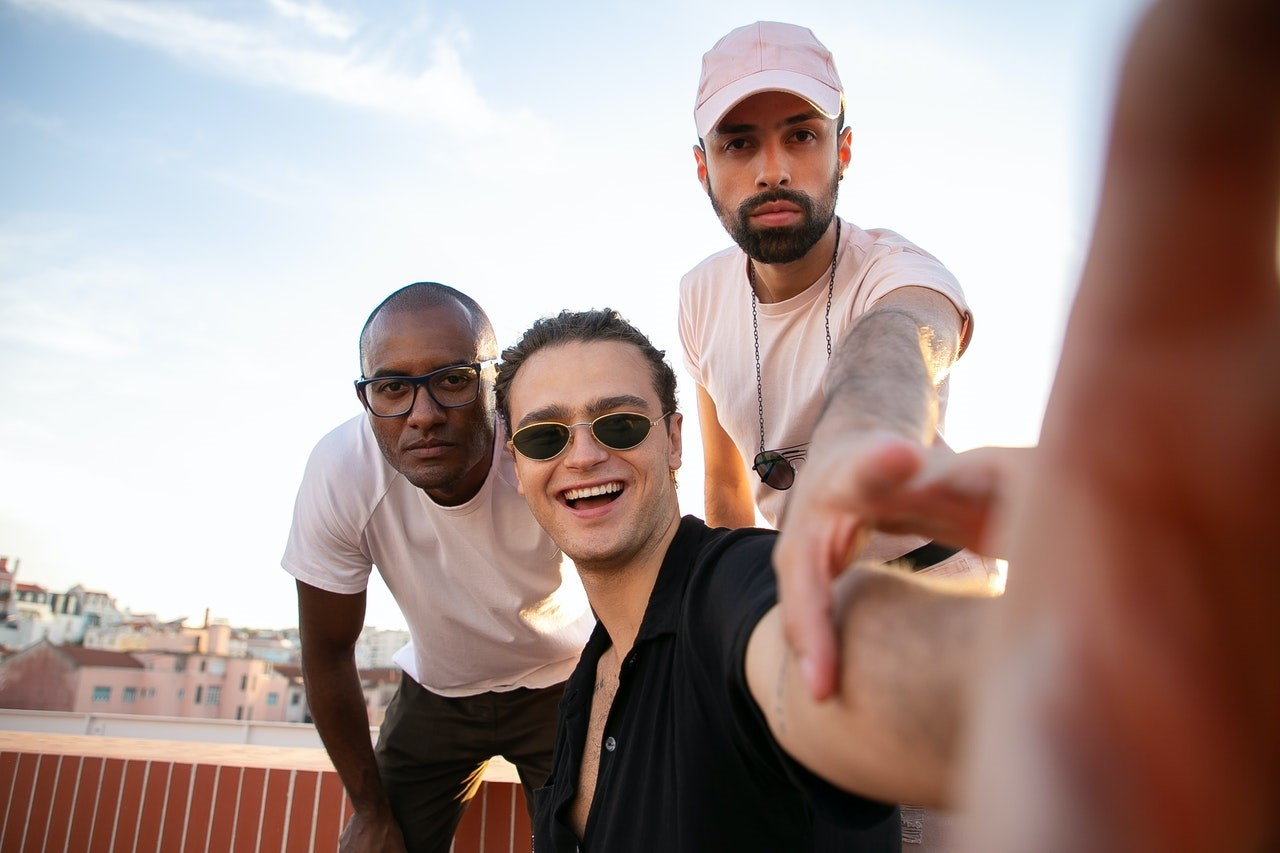 three guys taking a selfie