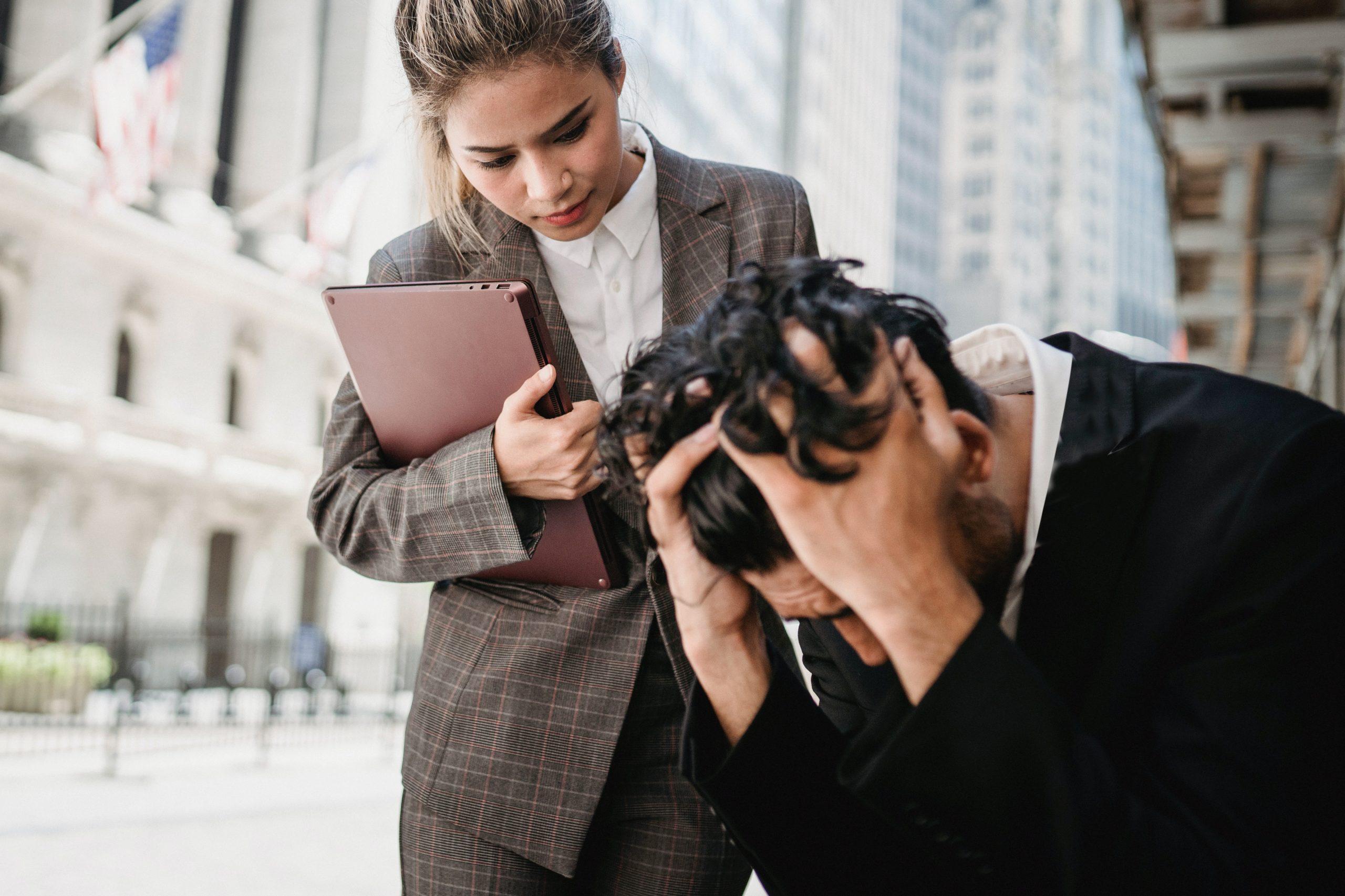 a woman calming down a worried man
