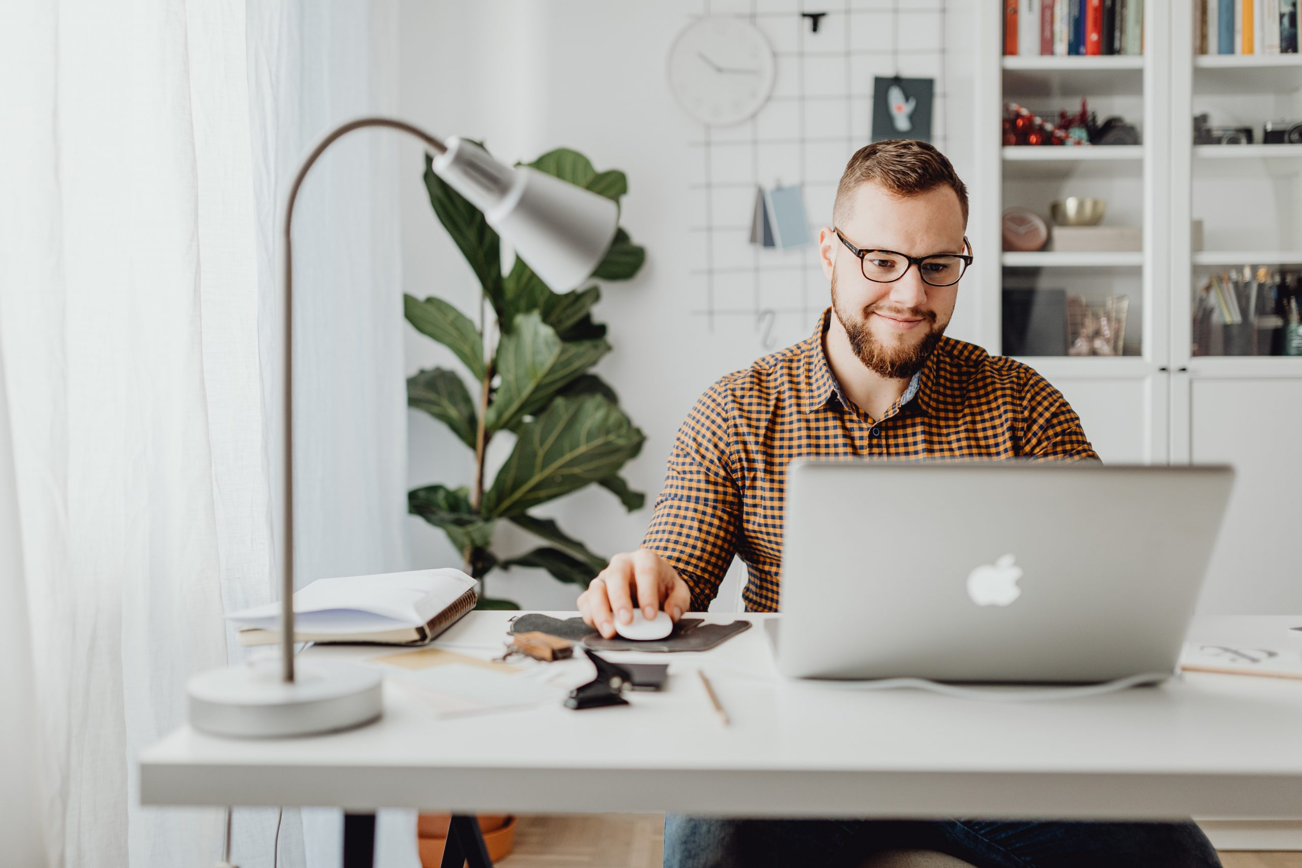 man sitting at a desk on a laptop