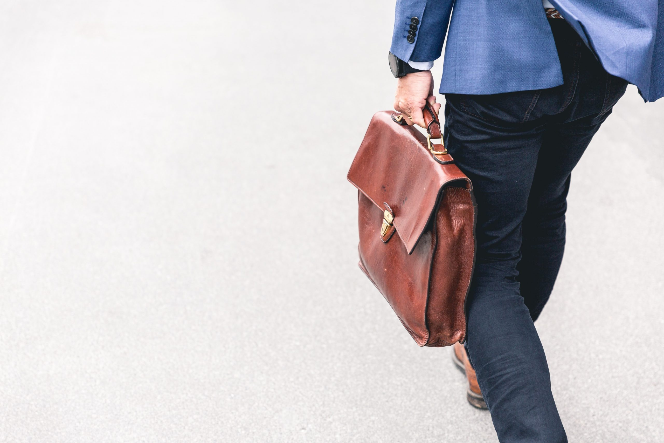 a man carrying a brown bag